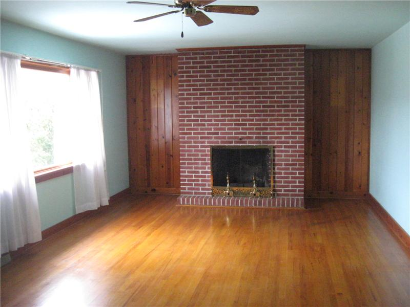 Living room with wood buring fireplace